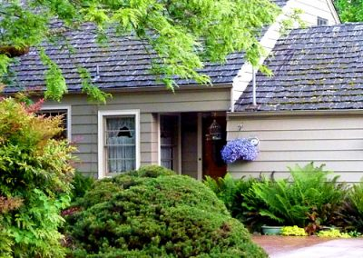 modest house image of Wolf Creek Cedar's wood cedar roof work